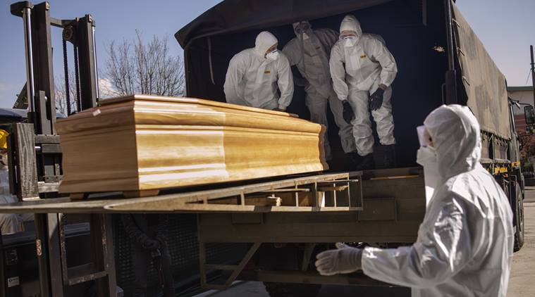 Members of the Italian army and the Carabinieri load the coffins of coronavirus victims onto a truck in Bergamo, Italy, March 24, 2020. Credit to Fabio Bucciarelli-The New York Times